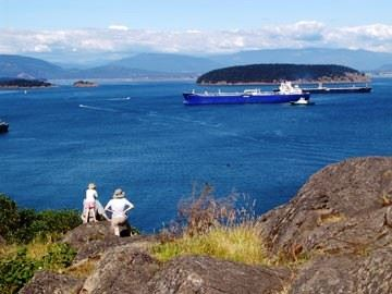 Family on Cliff Watching Ship